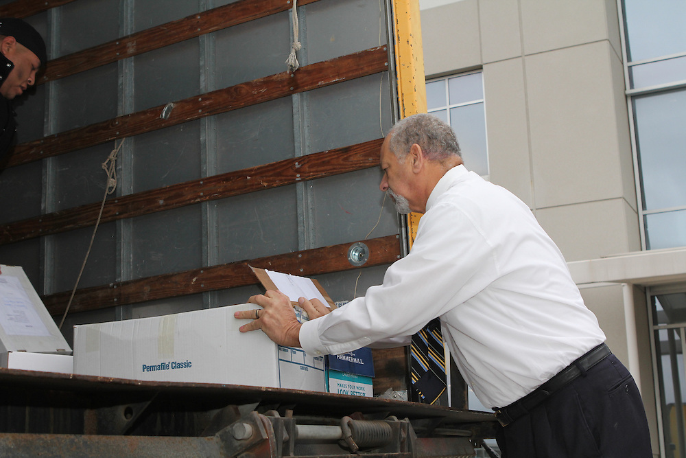 Elvis Eaglin, senior manager in Procurement, loads boxes of RFQs for transport to Construction Facility Services.