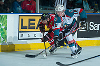 KELOWNA, CANADA - APRIL 14: Kole Lind #16  of the Kelowna Rockets checks Keoni Texeira #44 of the Portland Winterhawks  on April 14, 2017 at Prospera Place in Kelowna, British Columbia, Canada.  (Photo by Marissa Baecker/Shoot the Breeze)  *** Local Caption ***
