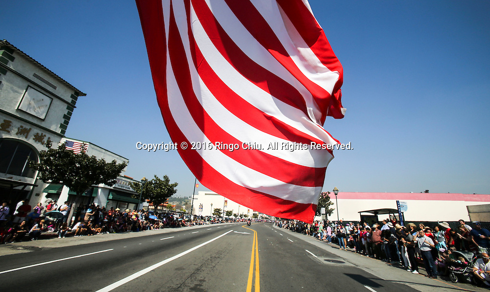 A U.S. flag is seen in the 117th annual Chinese New Year &quot;Golden Dragon Parade&quot; in the streets of Chinatown in Los Angeles, Saturday Feb. 13, 2016. (Photo by Ringo Chiu/PHOTOFORMULA.com)<br /> <br /> Usage Notes: This content is intended for editorial use only. For other uses, additional clearances may be required.