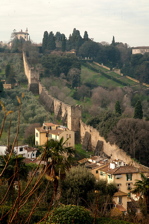 View from S. Miniato al Monte of the medieval and Renaissance fortifications that Michelangelo worked on for a year or two when the Florentine Republic was at war with the Medici supporters.  Beyond, the terraces of the newly opened Bardini Gardens.