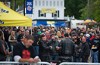 """A good crowd fills the street at the block party style """"Biketemberfest"""" early Saturday evening while the night was still young.  (Karen Bobotas/for the Laconia Daily Sun)"""