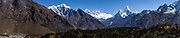 Mt Everest and Amadablam seen from near Namche Bazaar in the Himalayas, Nepal. Stitched panoramic image by Greg Beadle