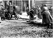World War I - 1914-1918.  After conscription in 1916, British women took over many civilian jobs.  Women resurfacing a city street in Westminster, London. Photograph.