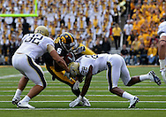 September 17, 2011: Iowa Hawkeyes wide receiver Keenan Davis (6)  is hit by Pittsburgh Panthers linebacker Tristan Roberts (32) and Pittsburgh Panthers defensive back Antwuan Reed (22) during the first half of the game between the Iowa Hawkeyes and the Pittsburgh Panthers at Kinnick Stadium in Iowa City, Iowa on Saturday, September 17, 2011. Iowa defeated Pittsburgh 31-27.