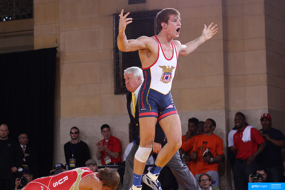 David Taylor, USA, (blue) winning against, Magomed Kurbanaliyev, Russia, (red) as wrestlers from USA, Iran and Russia compete at Grand Central Terminal as part of the Beat the Streets Gala. Billed ?The Rumble On The Rails,? the international wrestling event showcased competition as part of World Wrestling Month. Vanderbilt Hall, Grand Central Station, Manhattan,New York. USA. 15th May 2013. Photo Tim Clayton