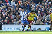 Brighton central midfielder, Beram Kayal (7) shields off Burnley midfielder Joey Barton (13) during the Sky Bet Championship match between Brighton and Hove Albion and Burnley at the American Express Community Stadium, Brighton and Hove, England on 2 April 2016. Photo by Phil Duncan.