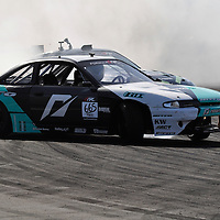 Matt Powers competing in the Formula DRIFT 2012 at Toyota Grand Prix of Long Beach Street Course