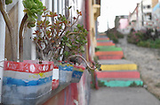 Colorful planters adorn a wall of the hilltop neighborhood of Cerro Alegre, Valparaiso.