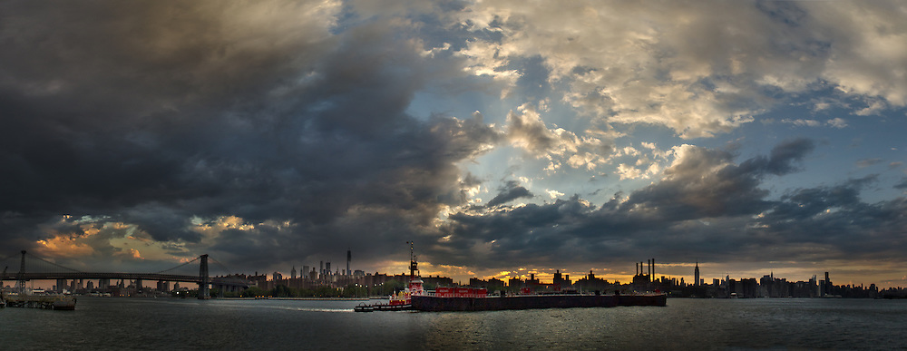 Dramatic Manhattan skyline view from Queens+tugboat