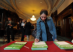 © Licensed to London News Pictures. 20/02/2012, London, UK. A woman signs the 'Petition for Marriage'. George Carey, former Archbishop of Canterbury, attends the launch of a new campaign against same sex marriage today, 20 February 2012. Colin Hart, campaign director of the Coalition for Marriage, who have published a report saying the British public reject gay marriage, chaired a press conference at One Great George Street, Westminster. Photo credit : Stephen Simpson/LNP