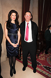 CHRISTINA ESTRADA JUFFALI and film director MIKE NEWALL at a reception hosted by Films Without Borders at the Lanesborough Hotel, Hyde Park Corner, London on 27th October 2010.