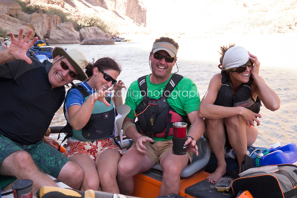 Four rafters goof off in a wind storm, Colorado River, Grand Canyon, AZ