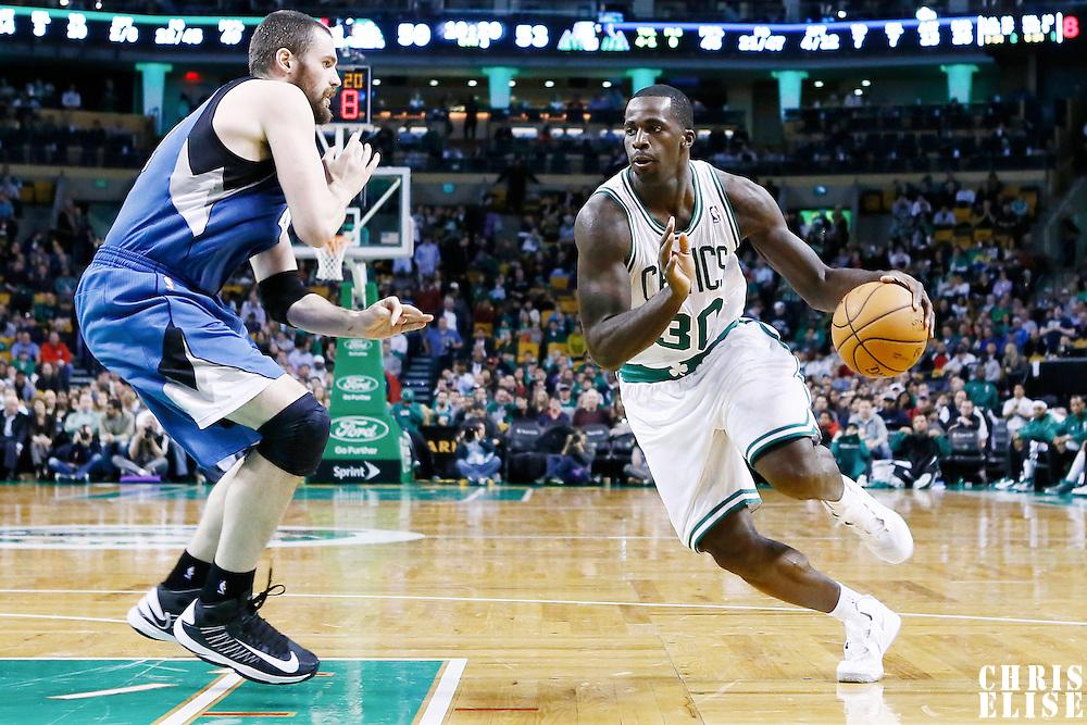 05 December 2012: Boston Celtics power forward Brandon Bass (30) drives past Minnesota Timberwolves power forward Kevin Love (42) during the Boston Celtics 104-94 victory over the Minnesota Timberwolves at the TD Garden, Boston, Massachusetts, USA.