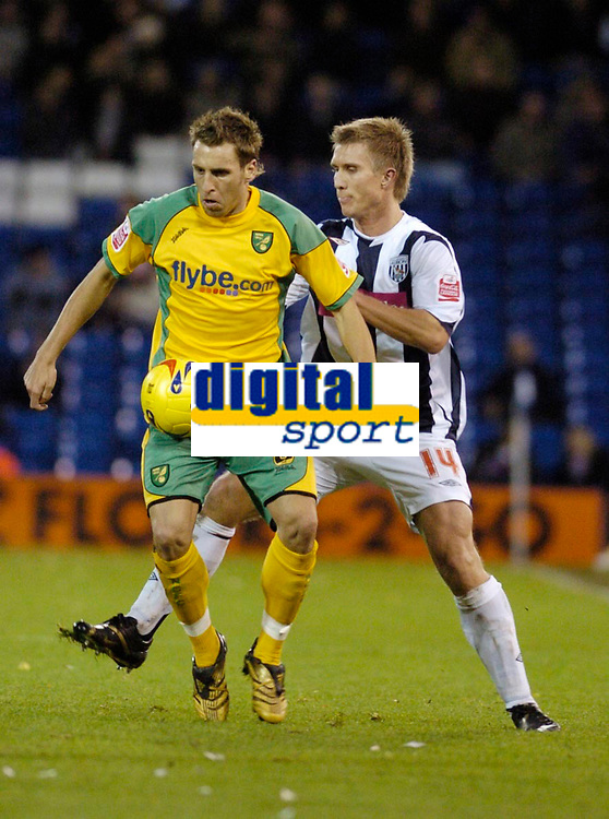 Photo: Leigh Quinnell.<br /> West Bromwich Albion v Norwich City. Coca Cola Championship. 11/11/2006. Norwichs' Darren Huckerby keeps the ball from West Broms Martin Albrechtsen.