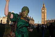 London 06/12/08 : The Campaign for Climate Change March : A protesters dances in Parliament Sqaure