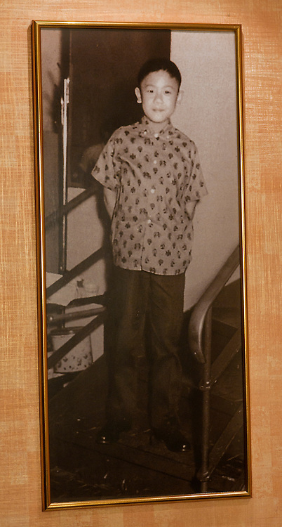 A photo of world famous chef, Ken Hom, in his youth hangs on the wall at his restaurant Maison Chin in Bangkok, Thailand.