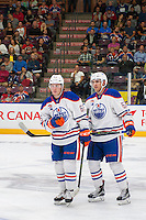 PENTICTON, CANADA - SEPTEMBER 17: Chad Butcher #65 and Patrick Russell #52 of Edmonton Oilers skate to the bench against the Calgary Flames on September 17, 2016 at the South Okanagan Event Centre in Penticton, British Columbia, Canada.  (Photo by Marissa Baecker/Shoot the Breeze)  *** Local Caption *** Chad Butcher; Patrick Russell;