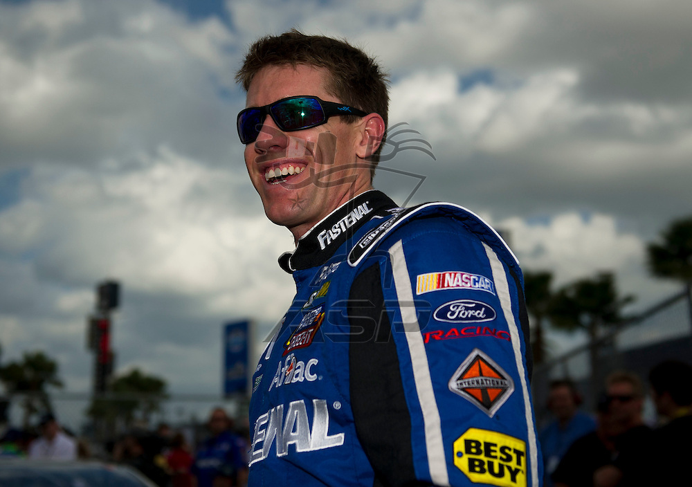 Daytona Beach, FL - FEB 19, 2012: Carl Edwards (99) gets out of the car during qualifying for the Daytona 500 at the Daytona International Speedway in Daytona Beach, FL.