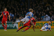 Femi Illesami  fouls Bristol Rovers midfielder Stuart Sinclair during the Sky Bet League 2 match between Bristol Rovers and York City at the Memorial Stadium, Bristol, England on 12 December 2015. Photo by Simon Davies.