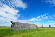 Roof of old barn rand old grain elevators<br /> Neidpath<br /> Saskatchewan<br /> Canada