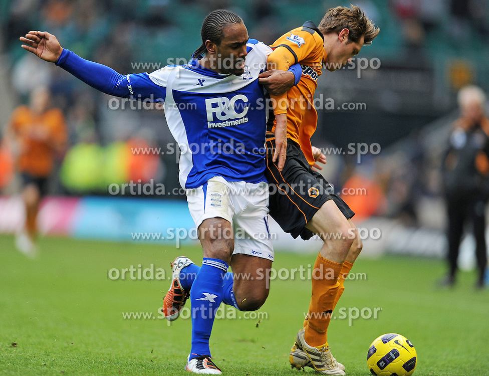 12.12.2010, Molineux stadium, Wolverhampton, ENG , PL, Wolverhampton Wanderers vs Birmingham City, im Bild Birmingham City`s Cameron Jerome  battles with Wolves's Richard Stearman  Wolverhampton Wanderers vs Birmingham City  in the  Barclays Premier League  at Molineux stadium in Wolverhampton on 12/12/2010. EXPA Pictures © 2010, PhotoCredit: EXPA/ IPS/ Rob Noyes +++++ ATTENTION - OUT OF ENGLAND/UK and FRANCE/FR +++++