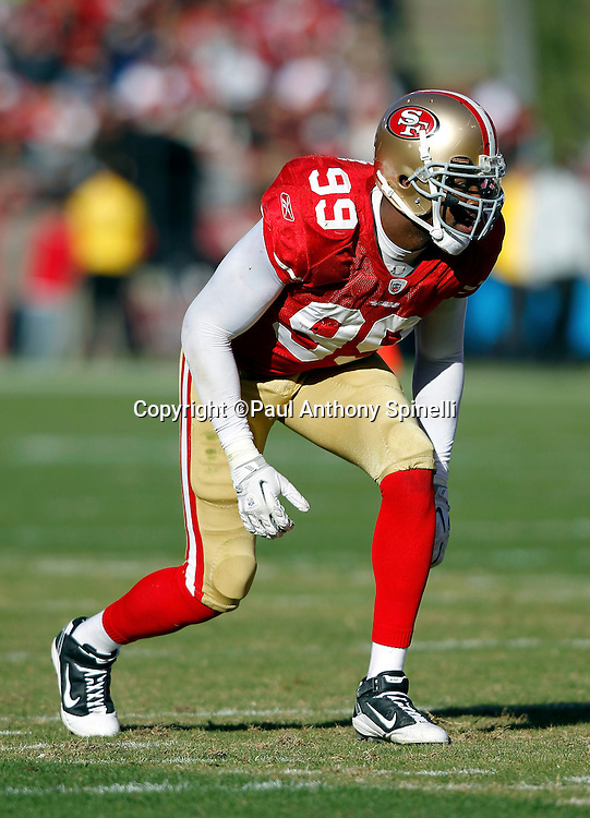 San Francisco 49ers linebacker Manny Lawson (99) gets set for the snap during the NFL week 11 football game against the Tampa Bay Buccaneers on Sunday, November 21, 2010 in San Francisco, California. The Bucs won the game 21-0. (©Paul Anthony Spinelli)