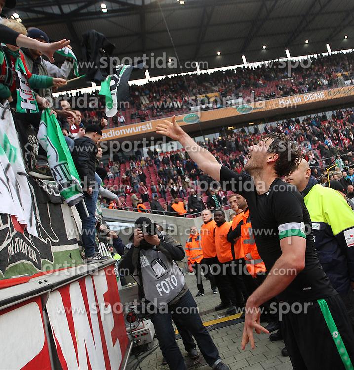 18.10.2015, Rhein Energie Stadion, Koeln, GER, 1. FBL, 1. FC Koeln vs Hannover 96, 9. Runde, im Bild Kapitaen Christian Schulz (Hannover 96 #19) verschenkt nach dem Sieg sein Trikot an die Fans // during the German Bundesliga 9th round match between 1. FC Cologne and Hannover 96 at the Rhein Energie Stadion in Koeln, Germany on 2015/10/18. EXPA Pictures &copy; 2015, PhotoCredit: EXPA/ Eibner-Pressefoto/ Schueler<br /> <br /> *****ATTENTION - OUT of GER*****
