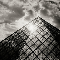 Black and white images of the Louvre museum architecture.