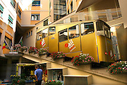 Switzerland, Lugano, A funicular tram passes by and through the hotels of Lugano.