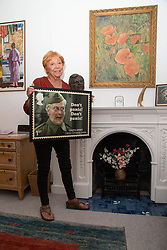 Priscilla Morgan admires a stamp design featuring her late husband Dad's Army's Clive Dunn. London, June 04 2018.
