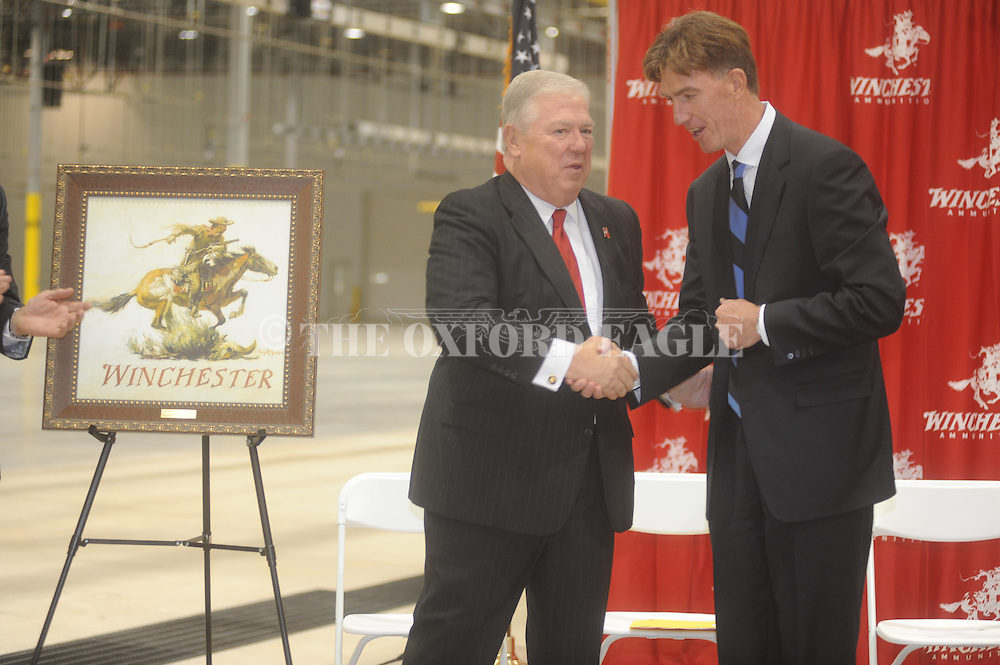 Mississippi governor Haley Barbour (left) shakes hands with Thomas O'Keefe, president of Winchester Ammunition, at a ribbon cutting for its Centerfire Ammunition Plant in Oxford, Miss. on Wednesday, October 12, 2011.  The expansion of Winchester's Mississippi operations is expected to create nearly 1,000 new jobs either directly or indirectly in Oxford by 2016 when the plant is fully operational.