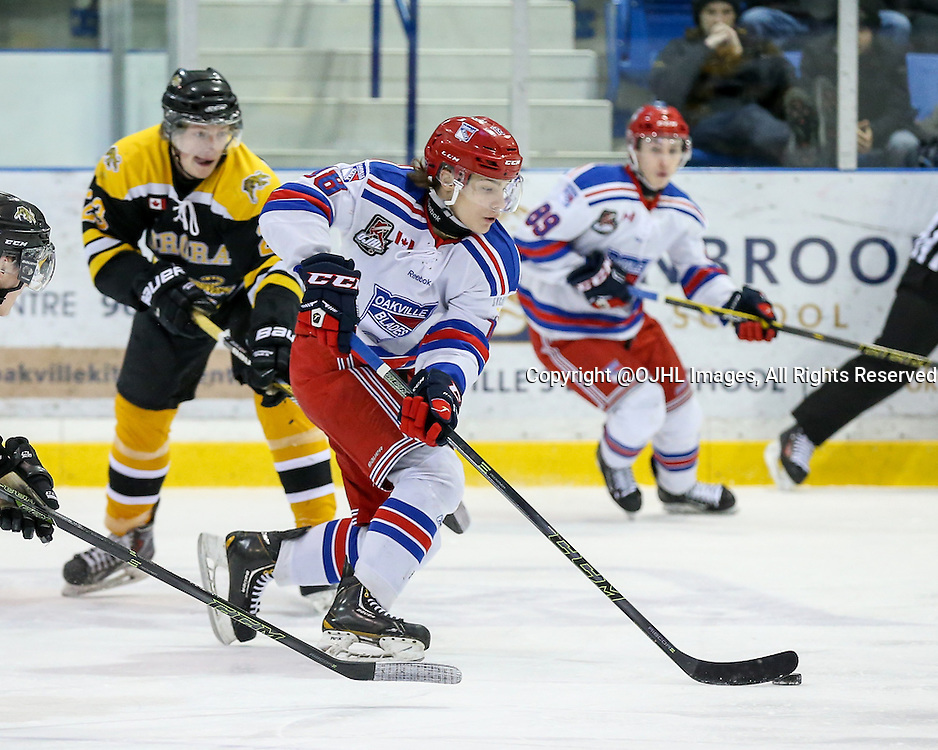 Oakville, ON - FEB 26 2016 - Ontario Junior Hockey League game action between Aurora Tigers and Oakville Blades at the Sixteen Mile Sports Complex Oakville, ON. Bryce Misley #18 of the Oakville Blades skates with the puck during the first period. <br /> (Photo by Kevin Sousa / OJHL Images)