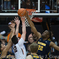 Oregon State's Drew Eubanks (12) get his shot blocked by California's Kingsley Okoroh (22) during the second half of an NCAA college basketball game in Corvallis, Ore., Saturday, Jan. 21, 2017. California won 69-58. (AP Photo/Timothy J. Gonzalez)