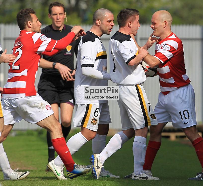 Alex Neil and Mark Gilhaney clash on the touchline during the Dumbarton FC  V Hamilton Academical FC  Scottish Championship  26th April 2014 ©Edward Linton | SportPix.org.uk