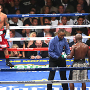 LAS VEGAS, NV - SEPTEMBER 13: (R-L) Floyd Mayweather Jr. complains to referee Kenny Bayless about Marcos Maidana during their WBC/WBA welterweight title fight at the MGM Grand Garden Arena on September 13, 2014 in Las Vegas, Nevada. (Photo by Alex Menendez/Getty Images) *** Local Caption *** Floyd Mayweather Jr; Marcos Maidana
