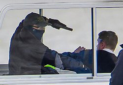 © Licensed to London News Pictures. 19/03/2017. London, UK. A man playing a terrorist holds a gun to the head of the captain of the boat as anti-terrorist Police intercept a tourist boat, taken hostage by people playing armed terrorists, in an ant-terror training exercise takes place on The River Thames in  London. It is the first time that an exercise of this type has taken place on the river. Photo credit: Ben Cawthra/LNP