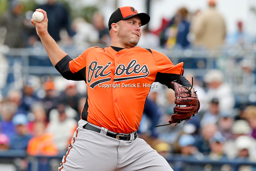 Mar 2, 2013; Port Charlotte, FL, USA; Baltimore Orioles starting pitcher Tommy Hunter (29) throws during the bottom of the fifth inning of a spring training game against the Tampa Bay Rays at Charlotte Sports Park. Mandatory Credit: Derick E. Hingle-USA TODAY Sports