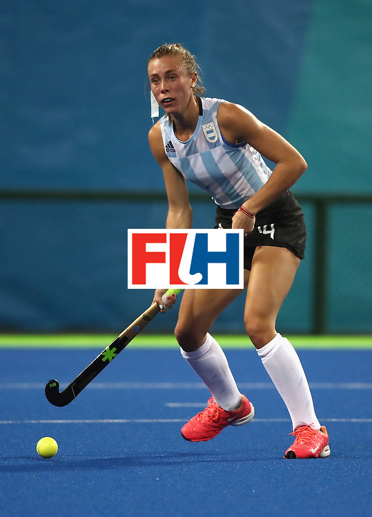 RIO DE JANEIRO, BRAZIL - AUGUST 06:  Agustina Habif #14 of Argentina looks to pass during a Women's Pool B match between the United States and Argentina on Day 1 of the Rio 2016 Olympic Games at the Olympic Hockey Centre on August 6, 2016 in Rio de Janeiro, Brazil.  (Photo by Sean M. Haffey/Getty Images)
