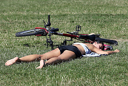 A cyclist enjoys the Indian summer in Green Park, London,  Monday, 2nd September 2013. Picture by Stephen Lock / i-Images