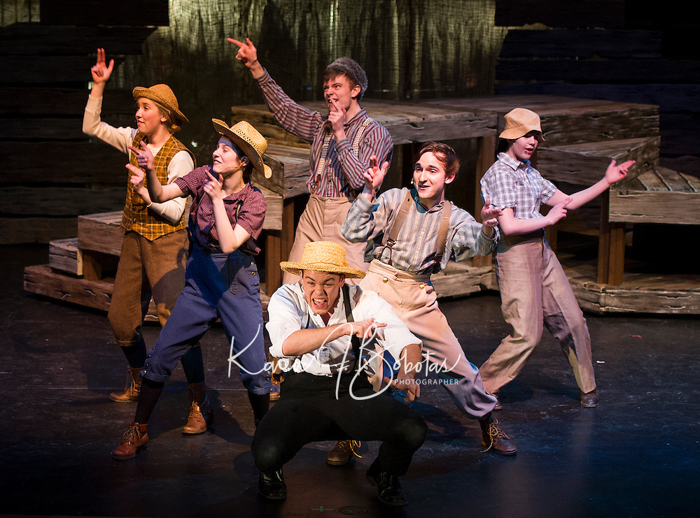 "(center) Tom Sawyer (John Masse) and Huckleberry Finn (Ben Kace) surrounded by the gang Teghan Kelly, Heather Hunt, Cameron Ouellette and Calista Mitchell during dress rehearsal for the production of ""Big River"" by the Winnipesaukee Playhouse at Inter Lakes High School's auditorium.  (Karen Bobotas/for the Laconia Daily Sun)"