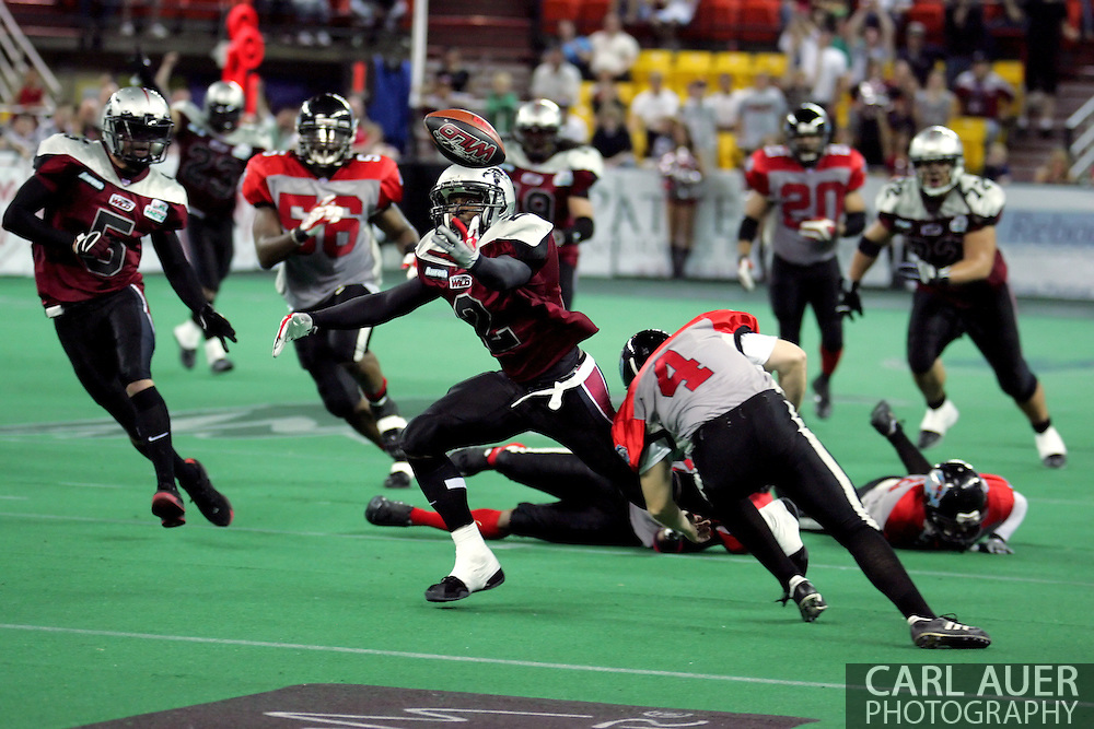 6-28-2007: Anchorage, AK - Alaska's Demarcus Morris (3) reaches for the ball he just fumbled in the Alaska Wild 47 to 53 loss to the CenTex Barracudas at the Sullivan Arena...