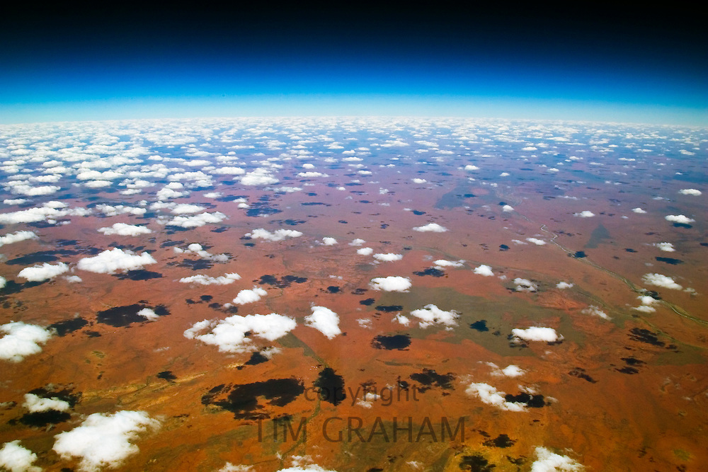 Red Centre viewed from aeroplane showing clouds and red earth over central Australia RESERVED USE - NOT FOR DOWNLOAD -  FOR USE CONTACT TIM GRAHAM