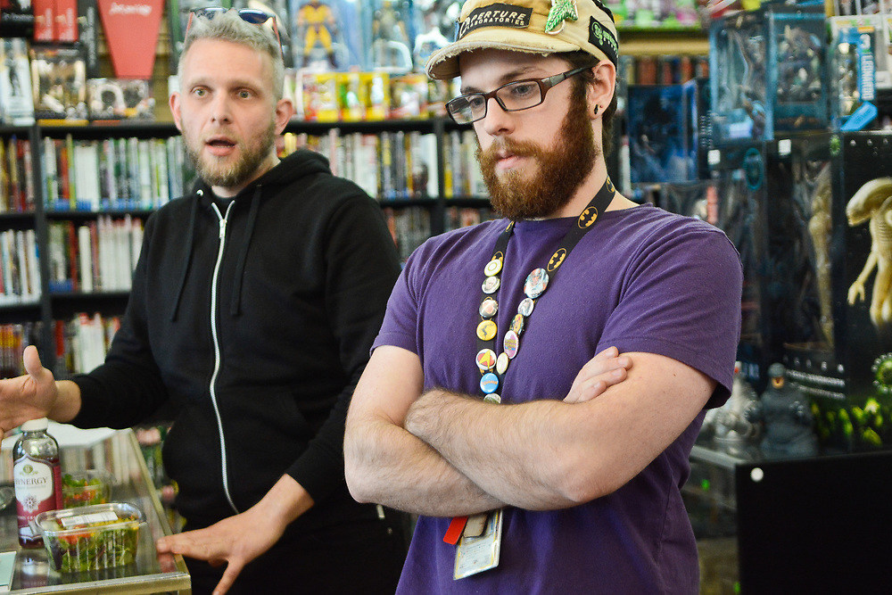 mkb030917/metro/Marla Brose  --  Joe Millard, right, assistant manager at Astro-Zombies, a comic book store, and Joe Annabi, left, manager of the store, talks about ART construction on Central Ave., Thursday, March 9, 2017. (Marla Brose/Albuquerque Journal)