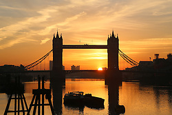 © Licensed to London News Pictures. 16/11/2013. London got off to a wonderfully sunny Autumn morning today with the sun rising behind Tower Bridge. The weather is predicted to soon take a turn for the worse. Credit : Rob Powell/LNP