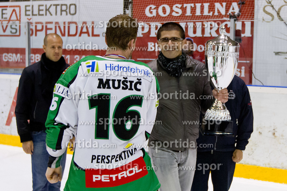 Ales Music (HDD Tilia Olimpija, #16) and Matjaz Rakovec, president of HZS,  with trophy after ice-hockey match between HK Acroni Jesenice and HDD Tilia Olimpija in fourth game of Final at Slovenian National League, on April 2, 2012 at Dvorana Podmezaklja, Jesenice, Slovenia. HDD Tilia Olimpija won 5:2 and become national champions in season 2011/12. (Photo By Matic Klansek Velej / Sportida.com)
