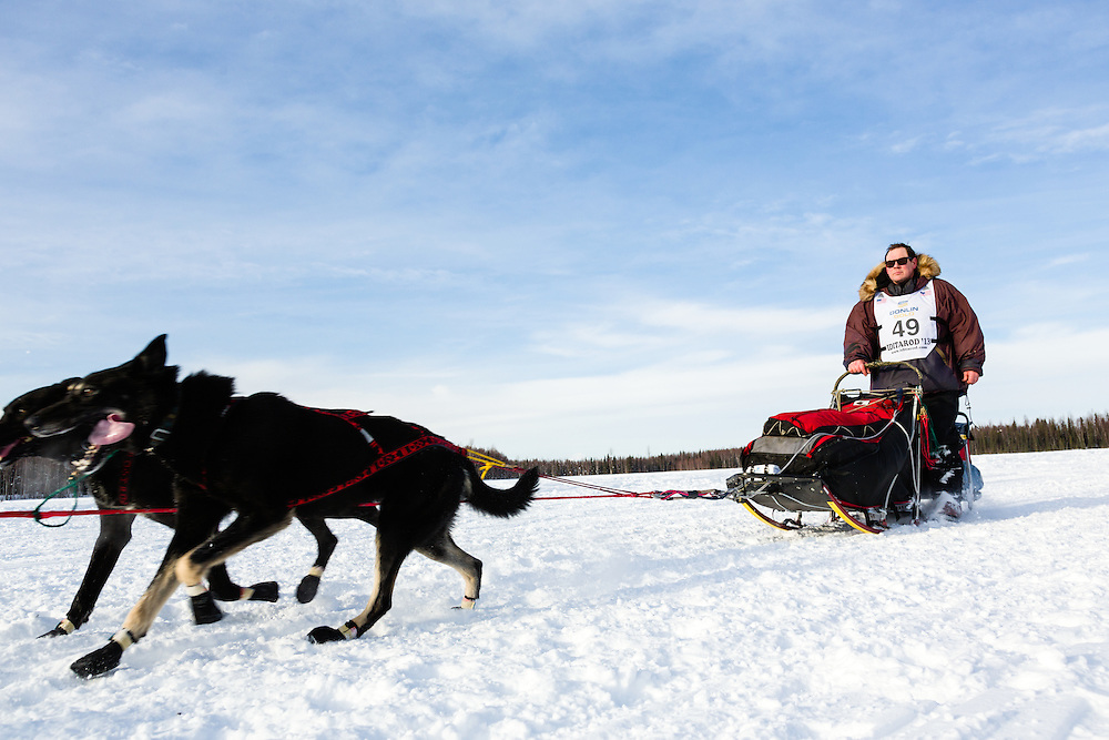 Musher Gerald Sousa competing in the 41st Iditarod Trail Sled Dog Race on Long Lake after leaving the Willow Lake area at the restart in Southcentral Alaska.  Afternoon.