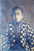 partly silver mirroring photo with portrait of a young boy wearing a kimono Japan