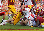 November 06 2010: Nebraska Cornhuskers running back Rex Burkhead (22) has his face mask pulled by Iowa State Cyclones linebacker A.J. Klein (47) as he scores a touchdown on a 2 yard run during the second half of the NCAA football game between the Nebraska Cornhuskers and the Iowa State Cyclones at Jack Trice Stadium in Ames, Iowa on Saturday November 6, 2010. Nebraska defeated Iowa State 31-30.