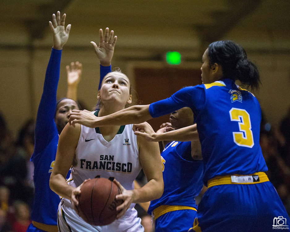 San Francisco Lady Dons forward Michaela Rakova (14) takes the ball to the basket against the San Jose State Spartans at Kezar Pavilion in San Francisco, Calif., on December 6, 2016. (Stan Olszewski/Special to S.F. Examiner)