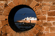 MOROCCO: Essaouira.The walled city see through a spy hole in the harbour wall